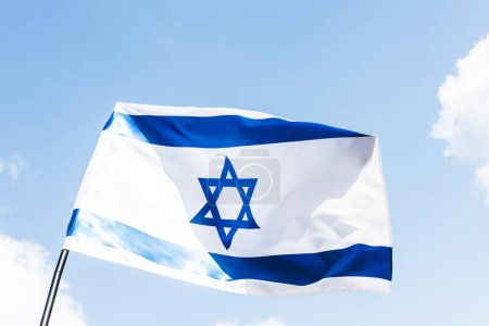 low angle view of national israel flag with blue star of david against sky