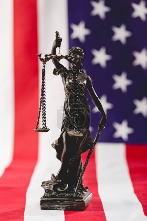 Photo for Selective focus of justice statue near american flag with stars and stripes - Royalty Free Image