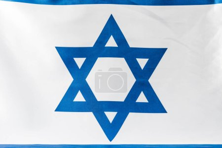 Photo for Close up of blue star of david on national flag of israel - Royalty Free Image