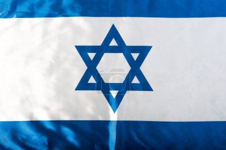 Photo for Close up of national israel flag with blue star of david - Royalty Free Image