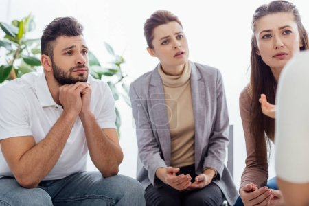 Photo for Group of people having discussion during therapy session - Royalty Free Image