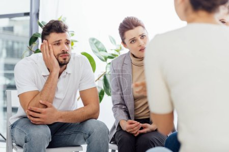 Photo for Group of people sitting and having discussion during therapy session - Royalty Free Image