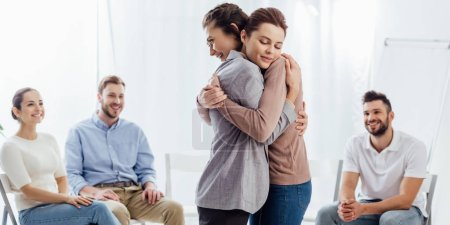 Photo for Panoramic shot of women hugging during group therapy session - Royalty Free Image