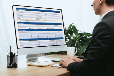 Photo for Cropped view of man filling in Personal Information Application Identity Private Concept - Royalty Free Image