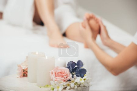 Photo for Selective focus of masseur doing foot massage to adult woman in spa - Royalty Free Image