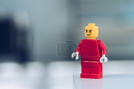 Photo for KYIV, UKRAINE - MARCH 15, 2019: selective focus of red lego figure with angry face on grey with copy space - Royalty Free Image