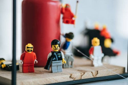 Photo for KYIV, UKRAINE - MARCH 15, 2019: selective focus of lego characters standing near candle with copy space - Royalty Free Image