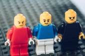 KYIV, UKRAINE - MARCH 15, 2019: Selective Focus of red, blue and black lego minifigures with various face expressions