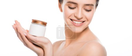 Photo for Panoramic shot of young woman holding container with face cream and smiling isolated on white - Royalty Free Image