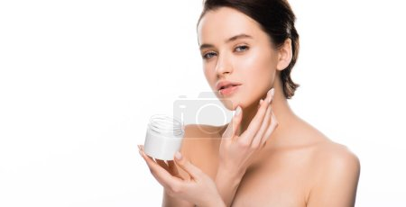 Photo for Panoramic shot of pretty woman holding container with cosmetic cream and looking at camera isolated on white - Royalty Free Image
