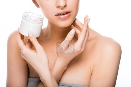Photo for Cropped view of woman holding container while applying cosmetic cream isolated on white - Royalty Free Image