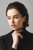 "Постер, картина, фотообои ""pensive young woman in black jumper isolated on grey """