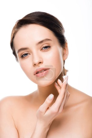 Photo for Attractive woman applying face cream and looking at camera isolated on white - Royalty Free Image
