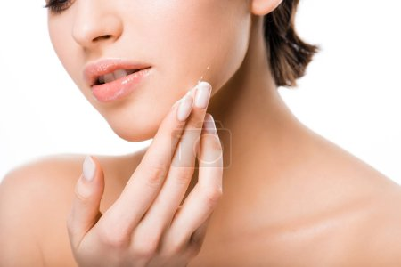 Foto de Cropped view of woman applying face cream isolated on white - Imagen libre de derechos