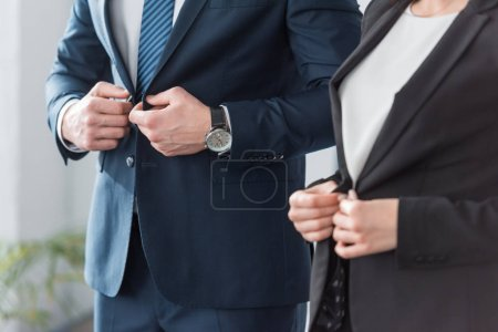 Photo for Cropped view of man and woman touching formal wear at home - Royalty Free Image