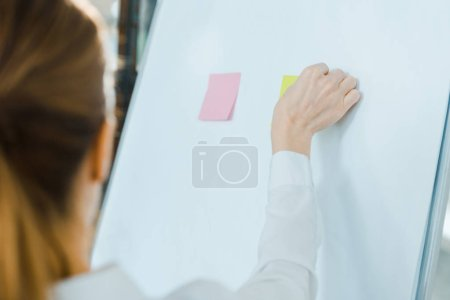 Photo for Selective focus of business coach putting sticky notes on white board - Royalty Free Image