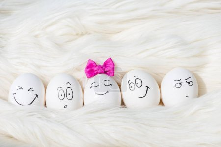Photo for Eggs with various face expressions on White Fur - Royalty Free Image