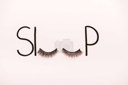 Photo for Top view of word sleep made with fake eyelashes isolated on beige - Royalty Free Image