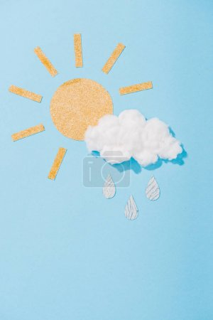 paper sun and cotton candy cloud with glitter raindrops on blue