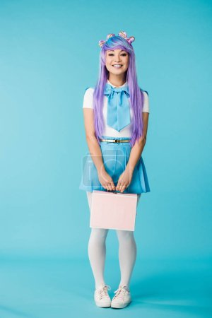 Full length view of anime girl in purple wig holding briefcase on blue