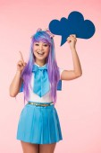 """Постер, картина, фотообои """"Excited asian anime girl holding blue thought bubble and showing idea sign on pink"""""""