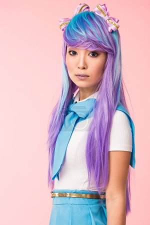 Photo for Beautiful asian anime girl in purple wig looking at camera isolated on pink - Royalty Free Image