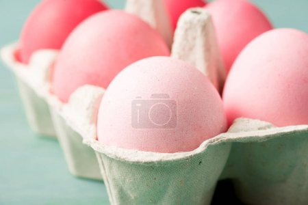 Photo for Selective focus of painted easter eggs in carrier on grey - Royalty Free Image