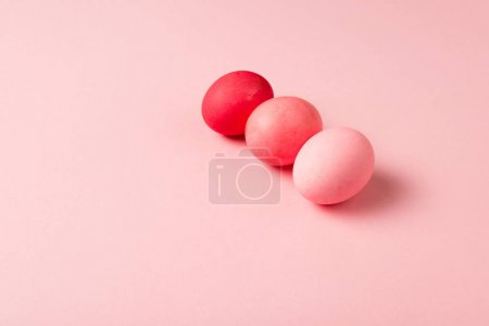 Photo for Three colorful painted easter eggs on pink surface - Royalty Free Image