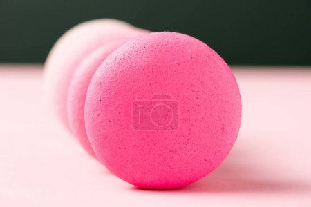 Photo for Selective focus of sweet colorful macarons on pink surface - Royalty Free Image