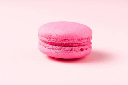 Photo for Bright macaron cookie with filling on pink surface - Royalty Free Image