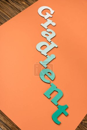 Photo for Gradient word made of green letters on bright orange paper - Royalty Free Image