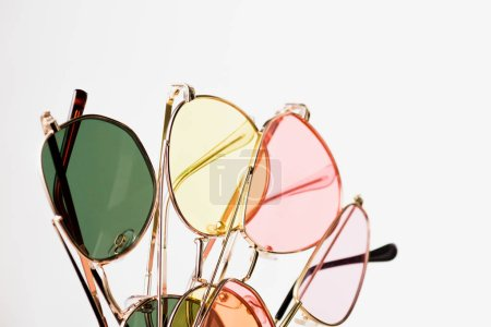 Photo for Top view of stylish colorful sunglasses on white - Royalty Free Image