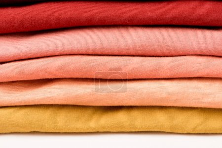 Photo for Stack of folded colorful clothes on white surface - Royalty Free Image