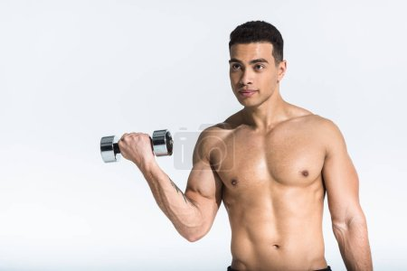 Photo for Handsome mixed race man with shirtless muscular torso holding dumbbell on white - Royalty Free Image