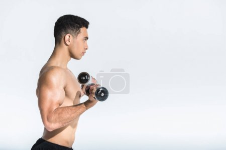 Photo for Side view of shirtless mixed race man training with dumbbells on white - Royalty Free Image
