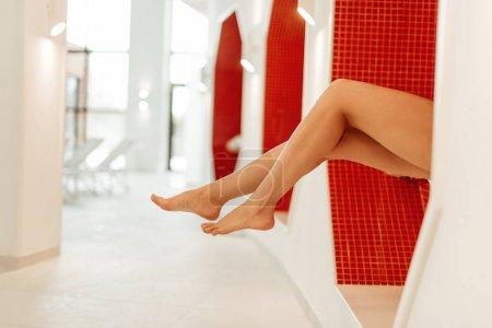 Photo pour Partial view of barefoot young woman in spa center - image libre de droit