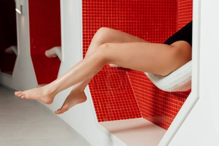 Photo for Partial view of barefoot young woman in spa center - Royalty Free Image