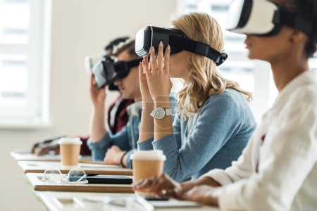 Photo for Selective focus of multiethnic students using vr headsets in university - Royalty Free Image
