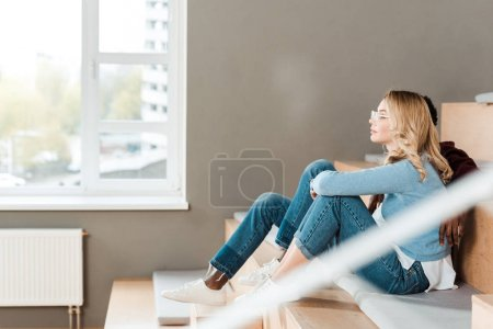 Photo for Side view of two multicultural students sitting in lecture hall - Royalty Free Image