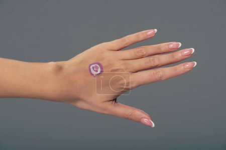Photo for Cropped view of female hand with viber logo isolated on grey - Royalty Free Image