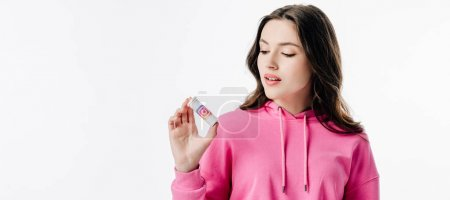 Photo for Panoramic shot of pretty young woman holding container with instagram logo isolated on white - Royalty Free Image