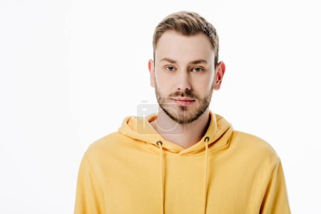 Photo for Handsome thoughtful man in yellow hoodie looking at camera isolated on white - Royalty Free Image