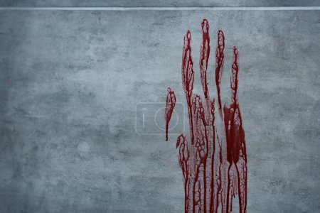 Photo for Red bloody hand print on grey textured surface - Royalty Free Image