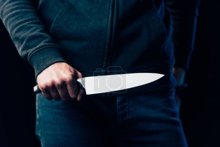Photo for Cropped view of murderer holding knife isolated on black - Royalty Free Image