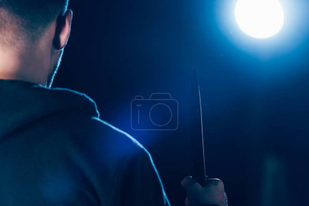 Photo for Cropped view of killer holding knife on black - Royalty Free Image