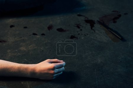 Photo for Partial view of dead man on floor at crime scene - Royalty Free Image
