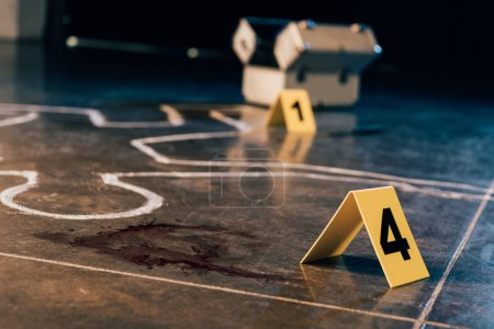 Photo for Chalk outline, blood stain, investigation kit and evidence markers at crime scene - Royalty Free Image