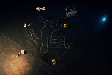 Photo for Chalk outline, smartphone, dollar banknote, shoe, investigation kit and evidence markers at crime scene - Royalty Free Image