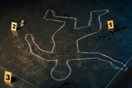 Photo for Chalk outline and evidence markers at crime scene - Royalty Free Image