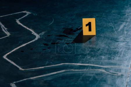 Photo for Chalk outline, knife and evidence marker at crime scene - Royalty Free Image